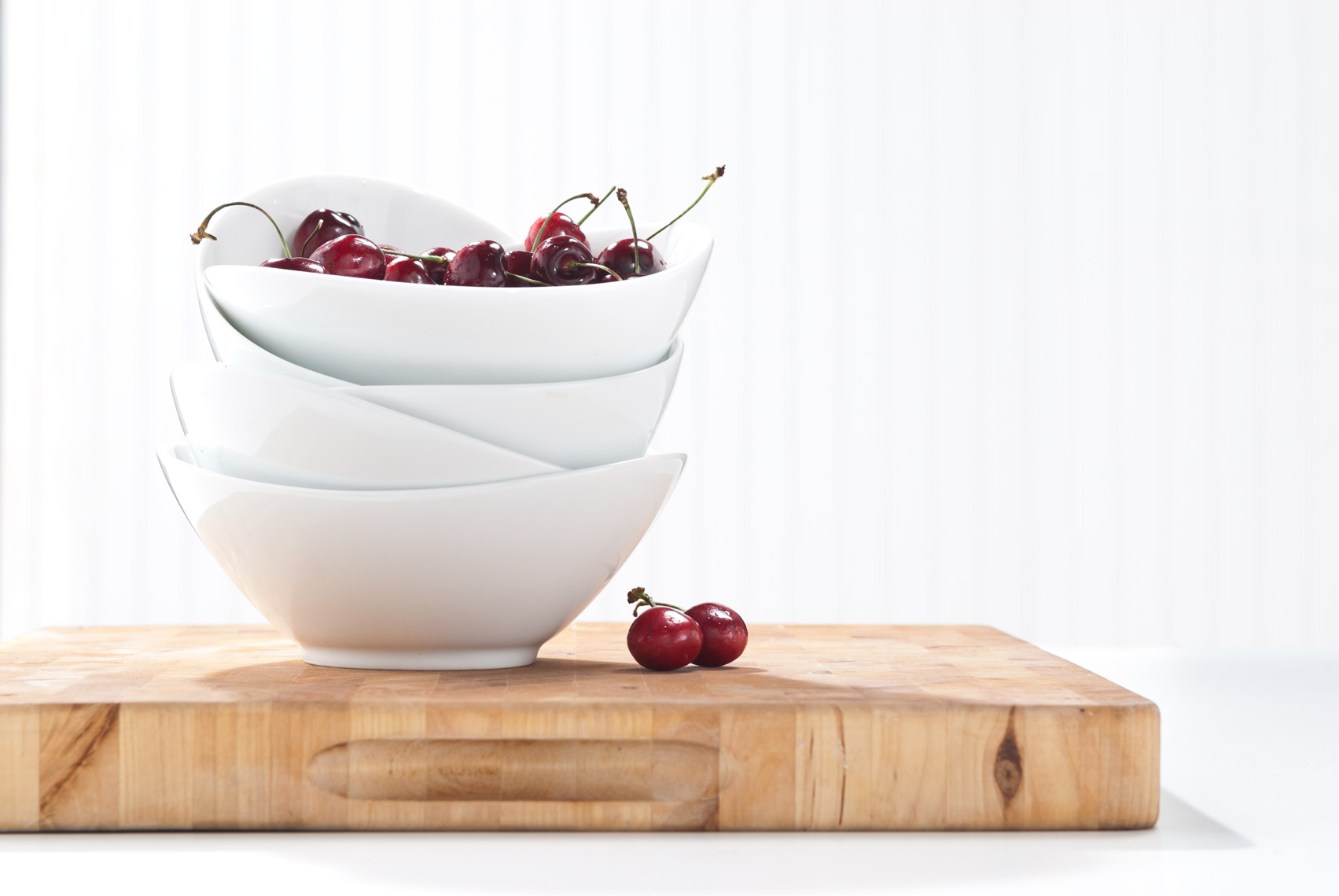 White_Bowls_On_Wood_With_Cherries